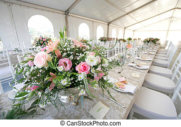 Wedding table - A table setup for a wedding reception in a...