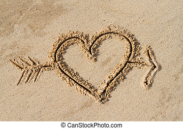 heart and arrow - A heart and arrow drawn in the sand
