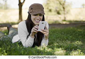 Young woman texting on hiking trip