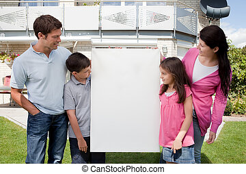 Family looking at a empty board outside house