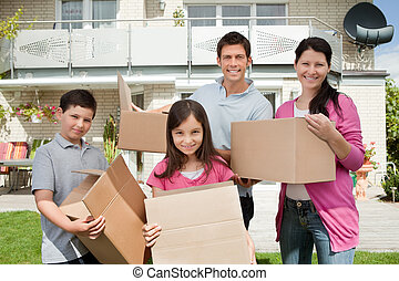 Young family shifting into new house - Happy young family...