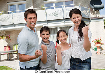 Excited family celebrating success - Portrait of excited...