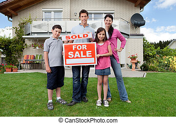 Young family happy to have bought a home - Portrait of happy...