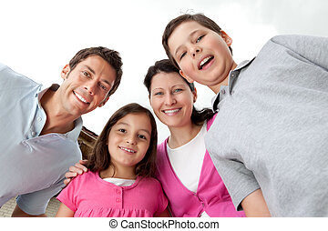 Portrait of cheerful young family together