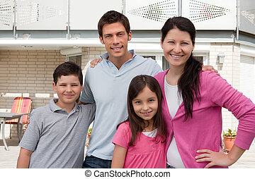 Beautiful young family standng together