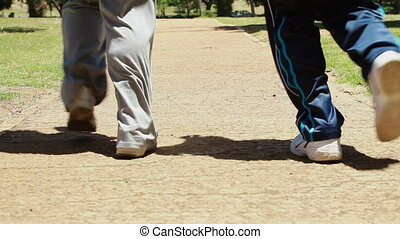 Mature couple jogging together in the countryside