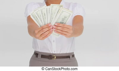Businesswoman holding dollars