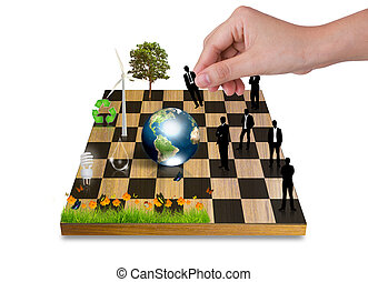 Hand Playing chess game with Silhouettes of business people...