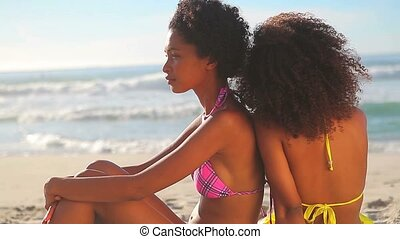 Peaceful women sitting on the beach