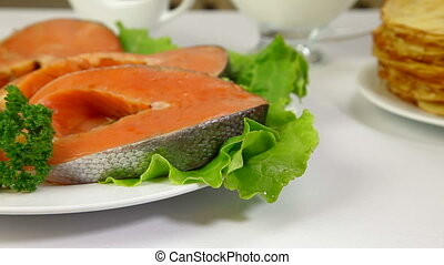 Salmon Steak - Fresh raw salmon stake on plate Tracking shot...