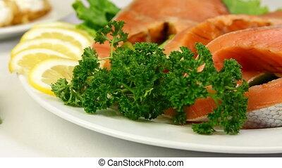 DOLLY: Salmon Steak Closeup - Fresh salmon stake on plate....