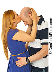 Woman kissing bald man forehead isolated on white background