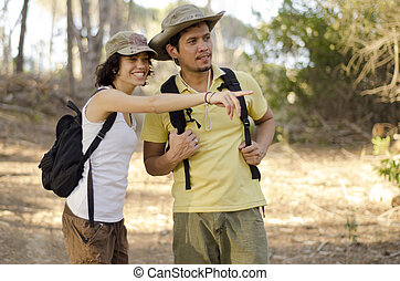Cute young couple on a hiking trip