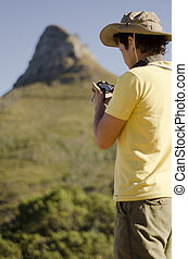 Young man taking photos on a trip