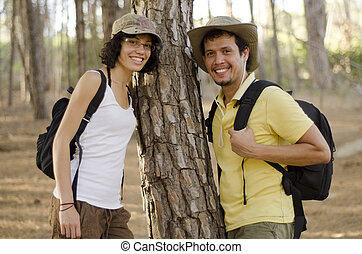 Cute young couple on a hiking trip - Portrait of a cute...
