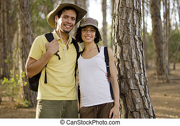 Cute couple on a hiking trip - Portrait of a cute young...