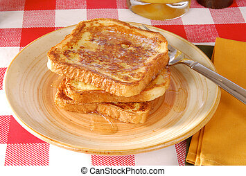 Golden french toast - A plate of golden brown french toast...