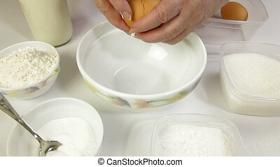 Whisking Eggs - Female preparing pancake batter in the...