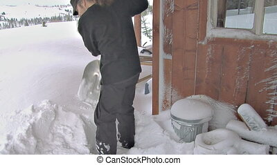 Shoveling Snow Off Deck Blizzard - The heavy lifting begins...