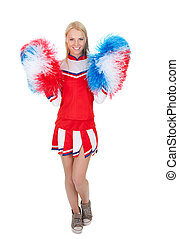 Smiling beautiful cheerleader with pompoms. Isolated on...