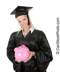 Female graduate student holding piggybank. Isolated on white