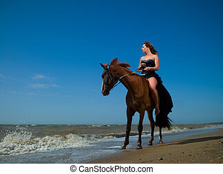 Girl and horse - Beautiful girl on a horse near the sea