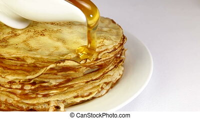 Stack Of Pancakes - stack of pancakes with syrup over white