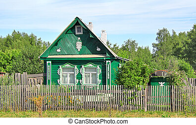 Village house - Green wooden house in a countryside