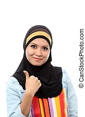 A smiling muslim with thumb up sign, isolated on white background