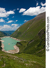 Kaprun Dam, lake and Alps in Austria