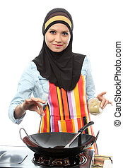 Action capture of a muslim female Chef adding spice on white