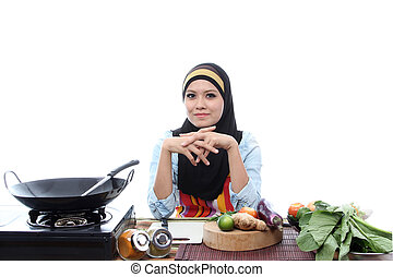Young Muslim Women Ready To Cook with smile on white