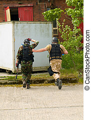 Soldier Escorting a captured combatant across yard
