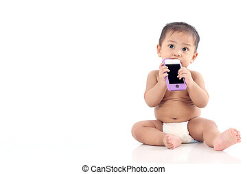Crying little asian baby plays with mobile phone with text...