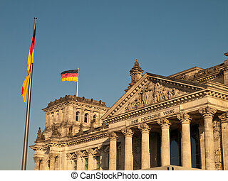 German Flag Flying over Reichstag Bundestag Building, Berlin...