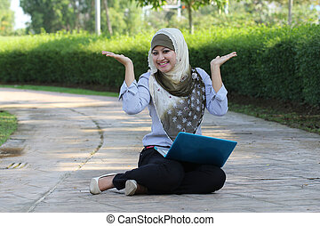 beautiful young Muslim girl happy emotion with laptop
