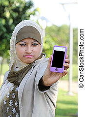 Young asian muslim girl angry with handphone text space
