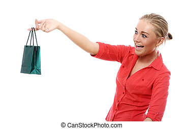 Happy woman with little shopping bag