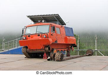 All-terrain vehicle - Repair of a red all-terrain vehicle
