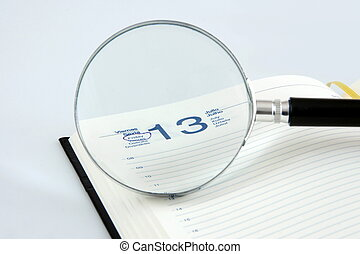 Friday 13 - A magnifying glass focusing a friday 13 in a...