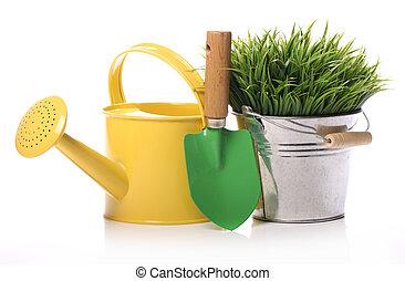 Different gardening stuff over white background