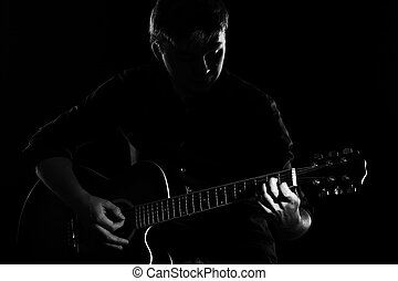 Man with guitar in darkness - Man with guitar in the...