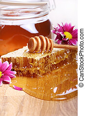 Honey on the wooden table - Fresh honey on the wooden table