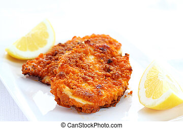 Fried chicken schnitzel with lemon
