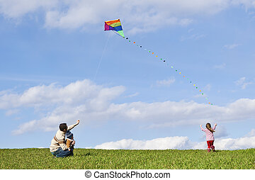 be active stay healthy - happy family with colofrul kite on...