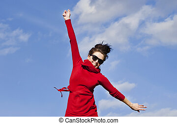 be active stay healthy - happy woman in the red cardigan