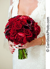 red rose bouquet - a bride holding her beautiful red flower...