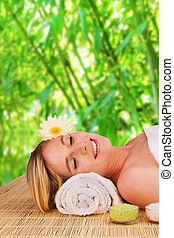 Beautiful blond woman relaxing, concept of spa