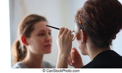 Make-up - Model making-up for photography in studio