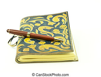 My Journal - Rosewood pen placed on leather journal, both...